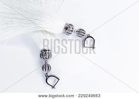 White Handmade Earrings-tassels On A White Background.