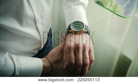 Closeup Designer Watch On Businessman Hand. Clip. Hand Of Businessman With A Clock.