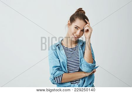 Spend Life On Bright Side. Indoor Shot Of Attractive Young Caucasian Student With Bun Hairstyle, Hol