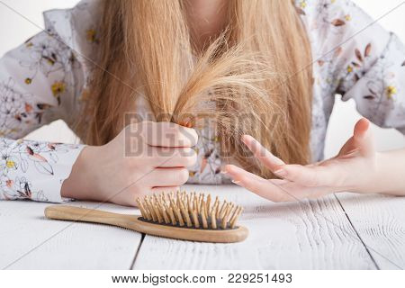 Hair Care. Closeup Of Beautiful Woman Hairbrushing Hair With Brush. Portrait Of Sexy Female Woman Br