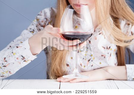 Young Woman With A Glass Of Wine. Addicted To Drugs And Alcohol.