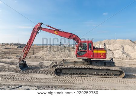 Lelystad, The Netherlands - February 02, 2018: Crane Operator In Excavator At Construction Site For