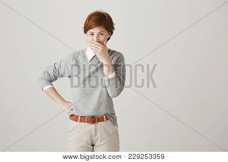Boss Is Shouting And Employee But She Can Not Hold Laugh. Indoor Shot Of Positive Cute Redhead Woman