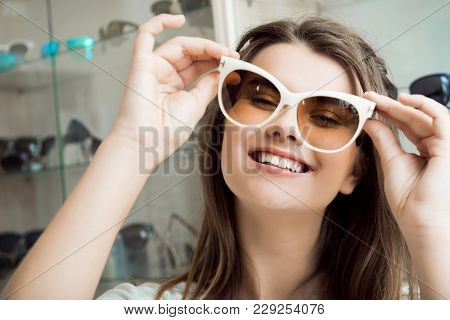 Eyes Deserve Best Lenses And Glasses. Portrait Of Good-looking Woman In Optician Store Picking New P