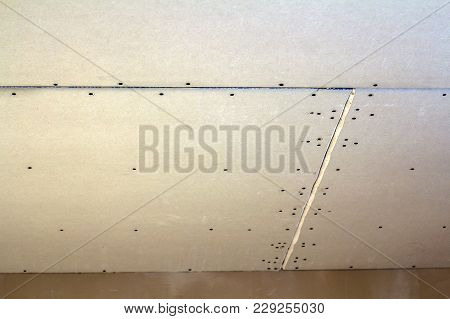 Suspended Ceiling From Drywall Fixed To Metal Frame With Screws.