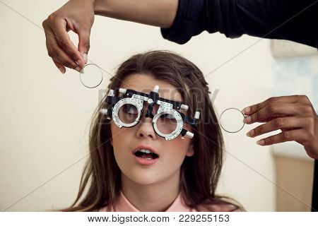 Eyecare And Health Concept. Portrait Of Curious And Entertained Young European Woman Sitting On Chai