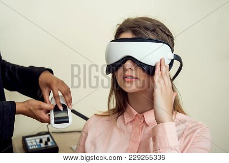 Girl Is Worried For Her Sight. Relaxed Modern European Woman Sitting In Office Of Eye Care Specialis