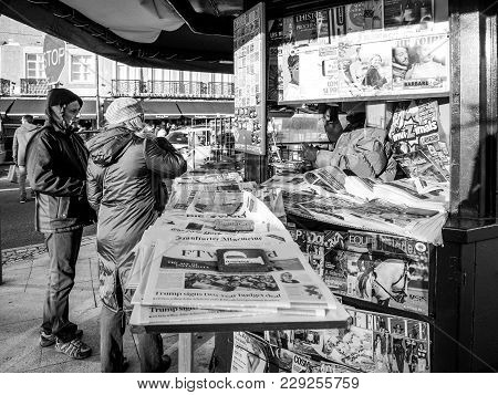 Lisbon, Portugal - Feb 10, 2018: Couple Buying Newspapers At The Lisbon Press Kiosk