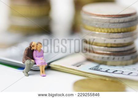 Senior couple with no money shortage, plastic figurine of two old citizens sitting on cash banknotes poster