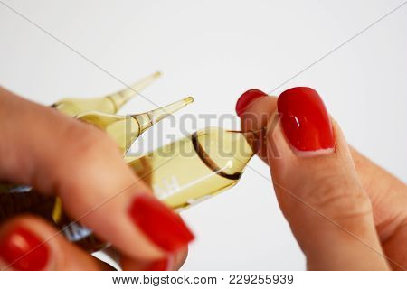 Woman Hand Holding Medical Ampules, Trying To Break For Treatment