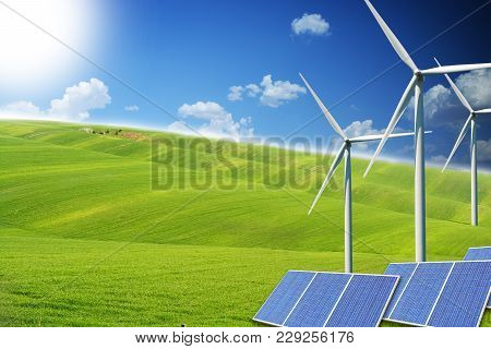 Renewable Energy Sources With Modern Solar Panels And Wind Turbines On Green Field