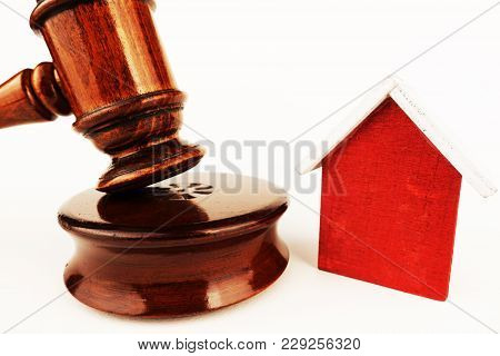 Property Auction Concept With Small Model House Near Judge Or Auctioneer Gavel