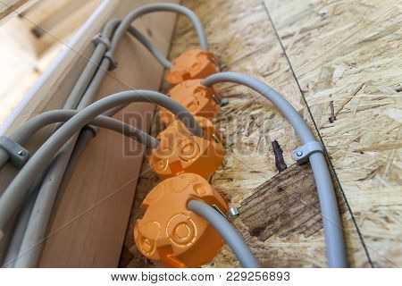 New Electrical Installation, Socket Plastic Boxes And Electrical Cables On The Wall, Renovation Conc