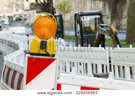 Orange Construction Street Barrier Light On Barricade. Road Construction On The Streets Of European
