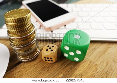 Online casino gambling or BET concept with dices and cash money in front of computer keyboard and smartphone poster