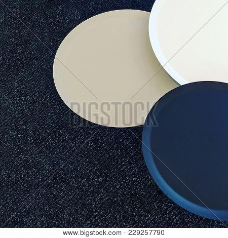 Set Of Round Tables On A Carpet Floor. Modern Design Furniture.