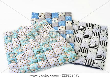 Bundle Of Colorful Patchworked Comforters With Unicorn And Stars Design On White Background - Three