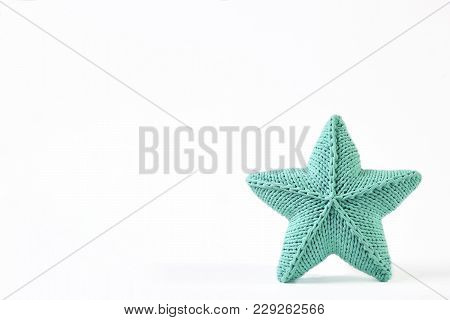 Blue-green Knitted Five-pointed Star Shaped Pillow On White Background