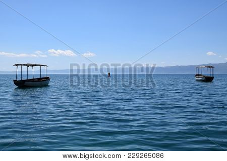 Two Boats Moored In Ohrid Lake, Macedonia.