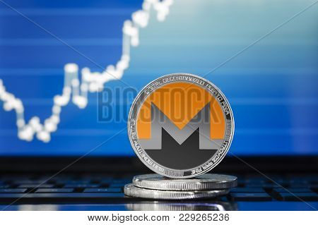 Monero (xmr) Cryptocurrency; Silver Monero Coin On The Background Of The Chart