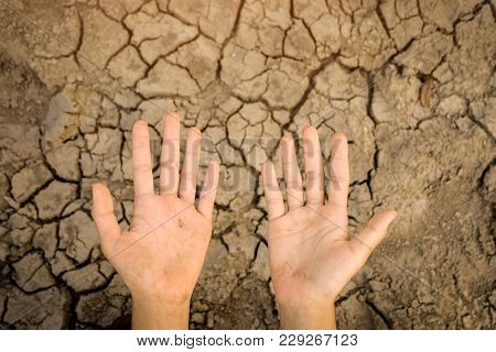 Hands Dirty On Cracked Barren Soil Background. Affected Of Global Warming Made Climate Change. Water