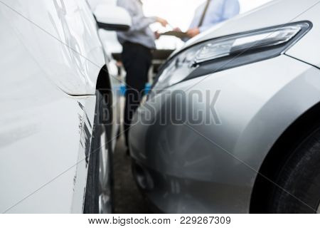 Traffic Accident And Insurance Concept, Insurance Agent Working On Report Form With Car Accident Cla