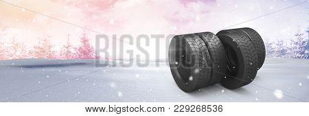 Digital composite of Tyres in Winter snow landscape