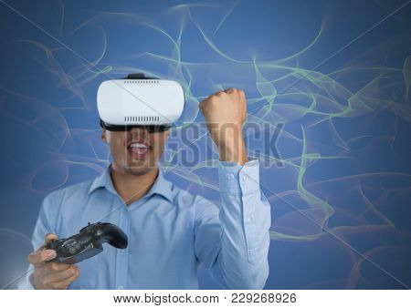 Digital composite of Businessman playing with computer game controller with virtual reality headset with squiggles