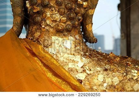 Back Side Of Golden Lord Buddha Statue In The Temple With Lots Of Gold Leaf Attached And The Backgro