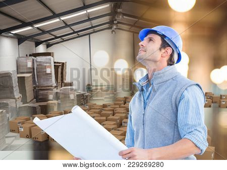 Digital composite of man with box in warehouse, transition