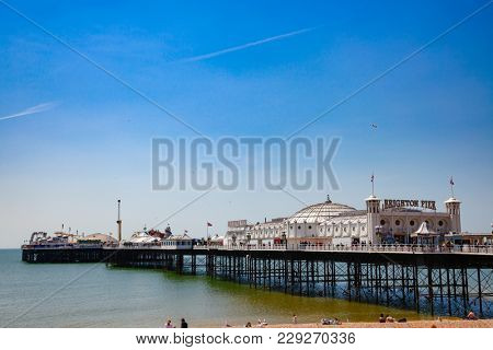 BRIGHTON, UK - JUN 5, 2013:View of the Brighton Palace Pier, commonly known as the Brighton Pier or the Palace Pier, the only one pleasure pier in Brighton still in operation
