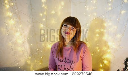 Cheerful Female Person Enjoying Party In Ornamented Cozy Room .young Student Enjoying Winter Vacatio