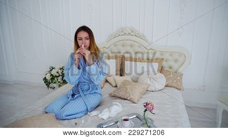 Appealing Woman Unwell, Suffering From Cold And In Pharmacy Herb Spray To Improve Health. Young Woma