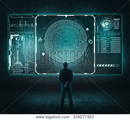 Business Concept. Back View Of Businessman Looking At A Maze On Touch Screen