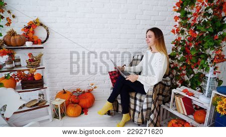 Cute And Confident Young Woman Doing Work On Errors And Recheck Adjustments In Control Work, Sitting