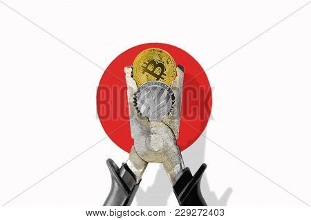 Bitcoin Coin Being Squeezed In Vice On Japan Flag Background; Concept Of Cryptocurrency Bitcoin (btc
