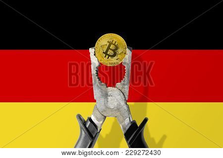 Bitcoin Coin Being Squeezed In Vice On The Germany Flag Background; Concept Of Cryptocurrency Bitcoi