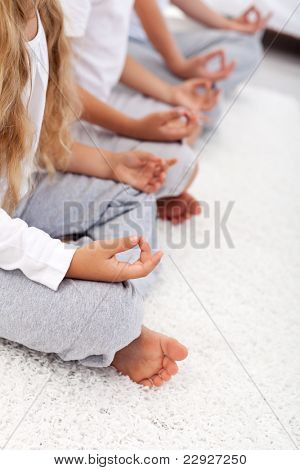 Yoga lotus position detail of kids and adult - relaxation concept