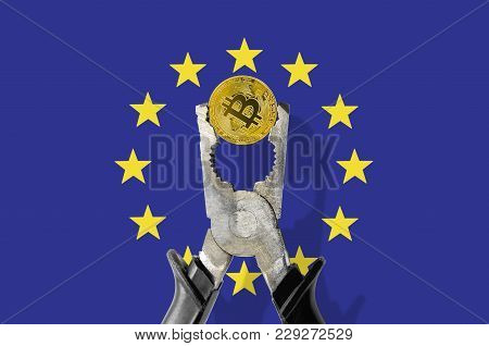 Bitcoin Coin Being Squeezed In Vice On The European Union Flag Background; Concept Of Cryptocurrency