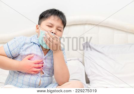 Sick Obese Boy Is Coughing And Throat Infection