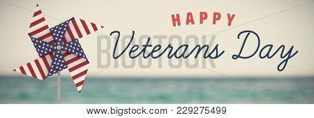 Logo for veterans day in america against message in bottle