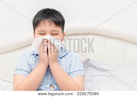 Obese Fat Boy Blowing The Nose By Tissue