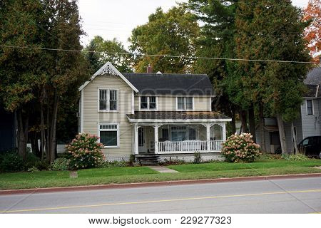 Bay View, Michigan / United States - October 16, 2017:  A Two Story Victorian Cottage With A Front P