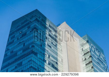 View From The Floor Of An Office And Business Building With Blue And Turquoise Windows With The Clea