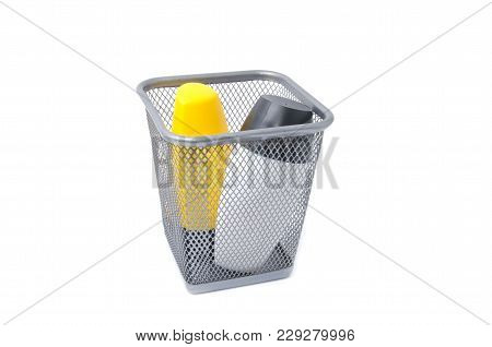 Waste Product In Metal Bin Isolated On White Background