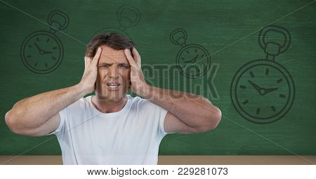Digital composite of frustrated man with clocks