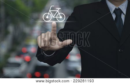 Businessman Pressing Bicycle Flat Icon Over Blur Of Rush Hour With Cars And Road, Business Service B