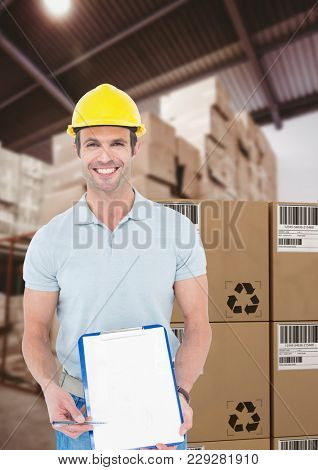 Digital composite of man with boxes in warehouse