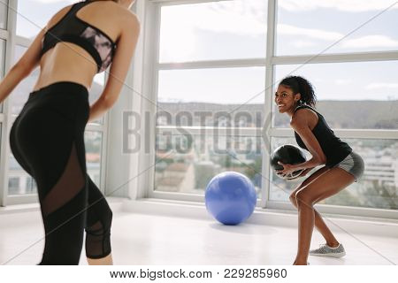 Woman Training On Agility Ladder In Gym. Fitness Class Cardio Workout With Speed Ladder No Floor.