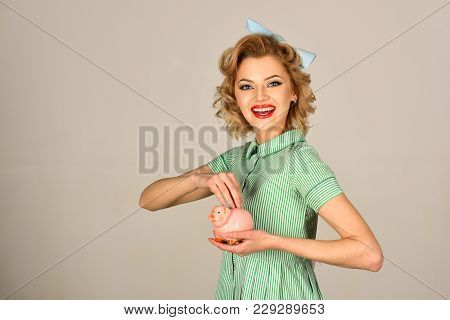 Happy Young Woman And Piggy Bank